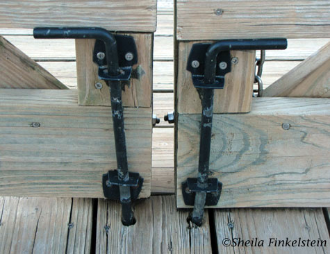 Iron bars locking wood gate at Green Cay