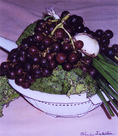 brocolli and grapes in a colander