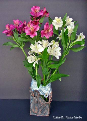 hand-built ceramic vase with burgundy and white alstromeria