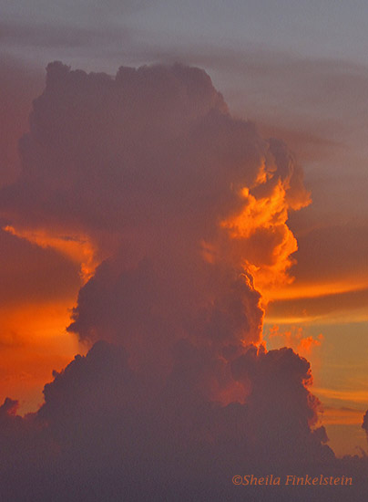 profile in the clouds at sunset from a balcony in Boynton Beach