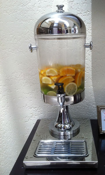 fruited water in an urn in a hotel lobby