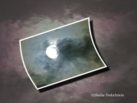 Full moon in clouds with insert