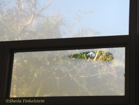 fogged patio window with opening