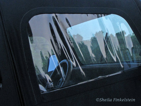 Reflections in front window of a Jeep