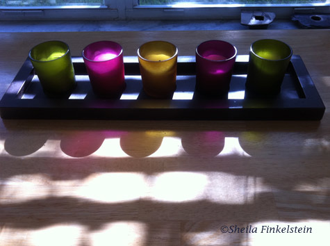 reflections, light and shadows - Colored candle holders on kitchen table
