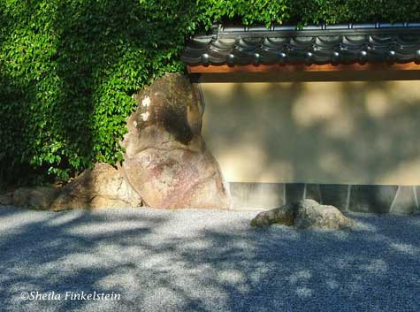 Large rock and wall in Contemplation Pavilion at the Morikami Museum and Japanese Gardens