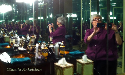 multi-images of Sheila in a mirrored room