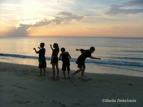 children celebrating sunrise