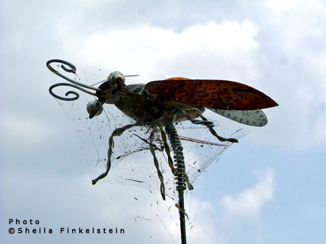 webbed insect sculpture